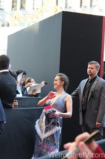 Elizabeth Henstridge posing for a fan\'s camera