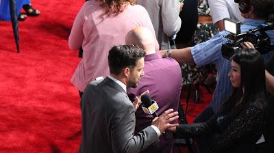 Jake Johnson being interviewed on the red carpet - Jurassic World Premiere
