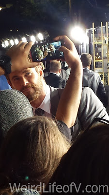 Chris Hemsworth taking photos with fans