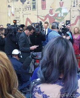 Tom Hiddleston among the press