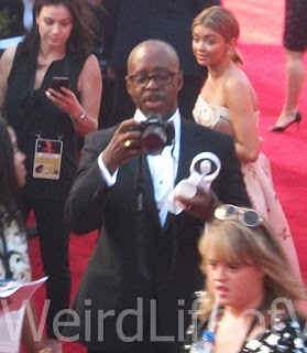 Courtney B. Vance taking photos of other people at the 2016 Emmys