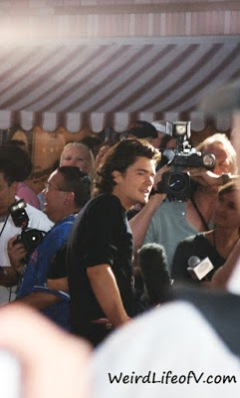 Orlando Bloom being interviewed on the red carpet at the Pirates of the Caribbean premiere