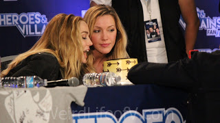 Caity Lotz and Katie Cassidy pose with Katie\'s birthday cake - Heroes and Villains Fan Fest San Jose 2015