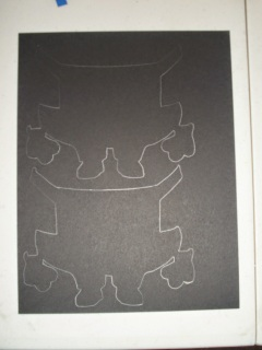 trace overalls piece onto black or blue cardstock