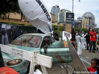 Old car set up promoting the Walking Dead Escape in the Petco Interactive Area outside San Diego Comic Con 2013.