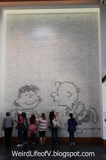 Mosaic mural of Charlie Brown and Lucy made up of ceramic tiles with comic strips printed on them - Charles M. Schulz Museum