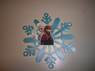 Glue image of Elsa and Anna to front of card