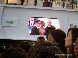 J.J. Abrams and Zoe Saldana on the screen