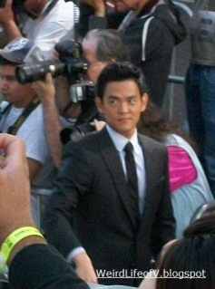 John Cho being cheeky with the fans in the bleachers